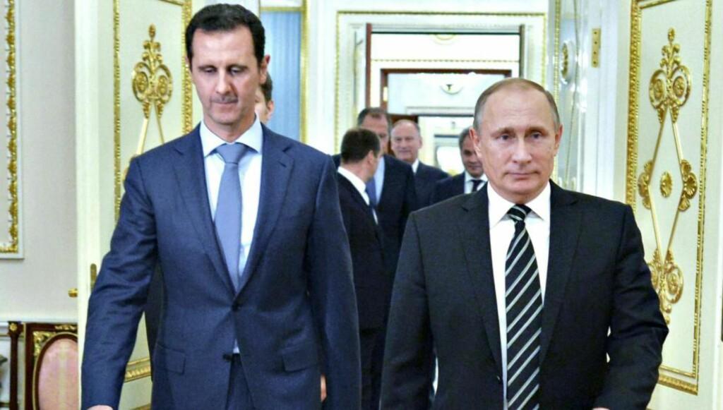 UTVISER FLYKTNINGER: Russlands president Putin, her med den syriske presidenten Bashar al-Assad.