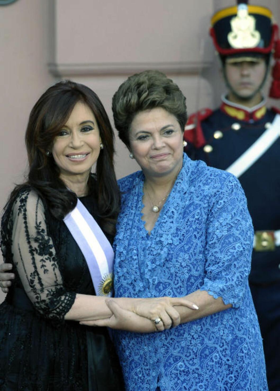 <strong>KVINNELIG MAKT:</strong> Dilma Rousseff overtok som Brasils første kvinnelige president 1. januar og 23. oktober ble Cristina Fernández gjenvalgt. Hun var fra før av den første folkevalgte kvinnelige presidenten i Argentina. Foto: Juan Mabromata/AFP