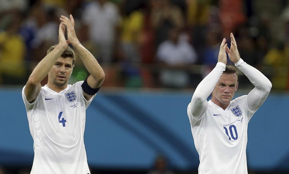 RIVALER OG VENNER: Steven Gerrard og Wayne Rooney har spilt for rivaliserende klubber, men har vært sammen på landslaget fra Rooneys debut til Gerrards avslutning i fjor. Gerrard hylles som en av tidenes beste engelske midtbanespillere av Rooney. Foto: AP Photo/Martin Mejia