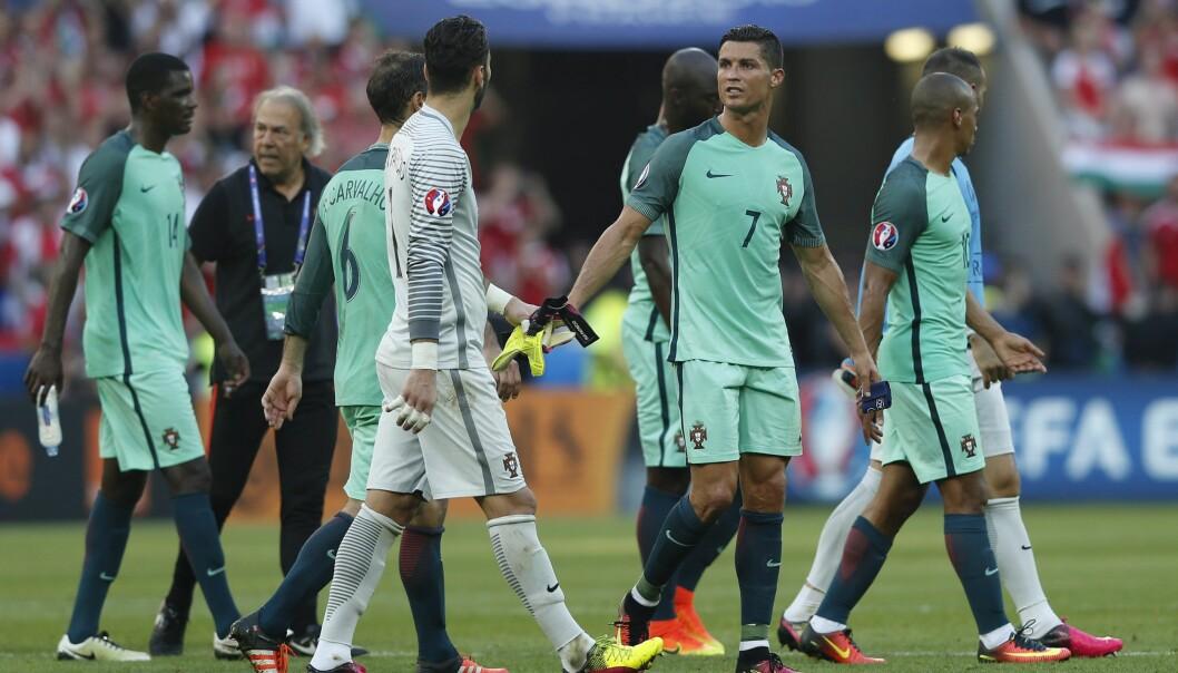 <strong>ET GODT RESULTAT FOR BEGGE:</strong> &nbsp;Portugals 3-3-kamp mot Ungarn sendte begge lag videre til EM-sluttspillet. Foto: NTB Scanpix