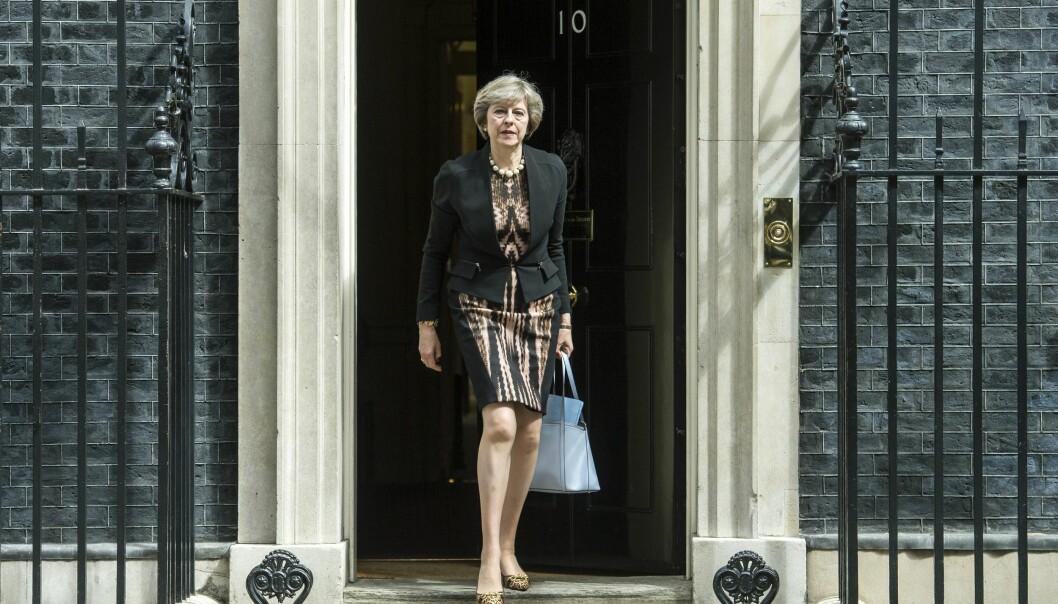 <strong>GODT KJENT I NO10 DOWNING STREET:</strong> Storbritannias innenriksminister Theresa May på vei fra et regjeringsmøte tirsdag. Seinere på dagen tok hun en knusende seier i den første avstemningen om å overta etter David Cameron. Foto: WILL OLIVER, EPA/NTB Scanpix.