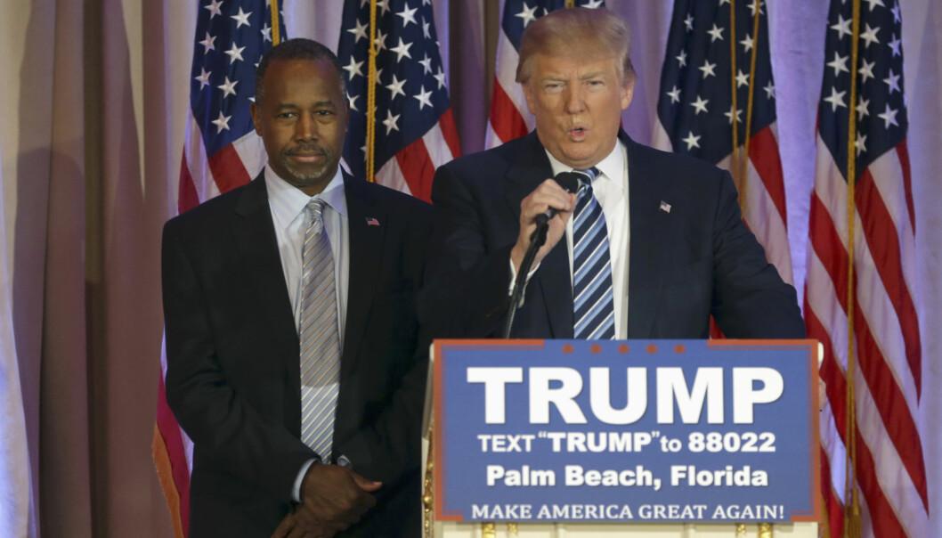 <strong>SAMMEN:</strong> Donald Trump (t.h.) fikk støtte fra Ben Carson kort tid etter at Carson avsluttet sitt eget forsøk på å bli republikanernes presidentkandidat. Foto: &nbsp;Lynne Sladky / AP Photo / NTB Scanpix