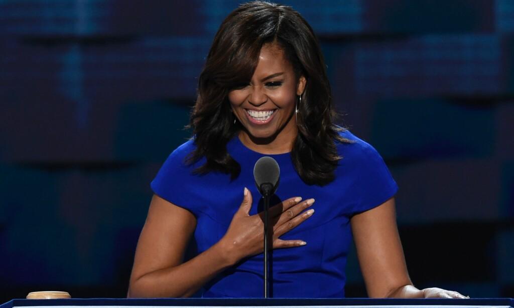 ØNSKES SOM PRESIDENT: Michelle Obama får tusenvis av oppfordring på sosiale medier om å stille som presidentkandidat om fire år. Foto: AFP PHOTO / SAUL LOEB