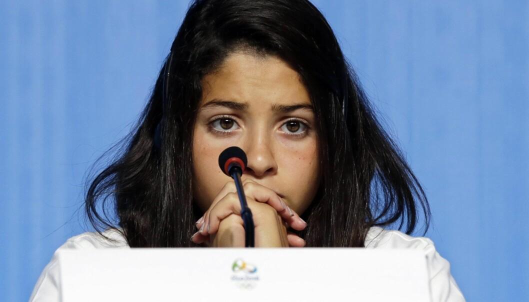 <strong>OL-DELTAKER:</strong> Yusra Mardini fra Syria måtte flykte fra livet i hjemlandet og bidro til å redde 19 andre da båten fikk problemer. Nå svømmer hun i OL. Foto: &nbsp;EPA/BARBARA WALTON