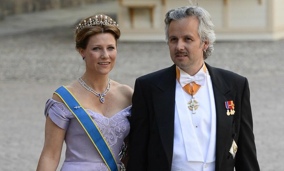 SKILLES: Prinsesse Märtha Louise og Ari Behn skal skilles, etter 14 års ekteskap. Her avbildet i forbindelse med bryllupet til prinsesse Madeleine i Stockholm i 2013. Foto: Jonathan Nackstrand /AFP / NTB Scanpix