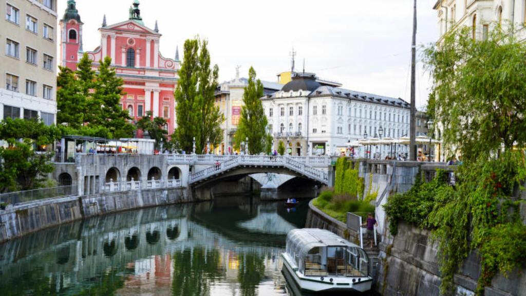 BYPERLE: Slovenias hovedstad Ljubljana feiret 2000 år i 2014. Jubileum eller ei, så er Ljubljana en av Europas best bevarte storbyhemmeligheter, og en by det absolutt er på tide å oppdage. Foto: TORILD MOLAND
