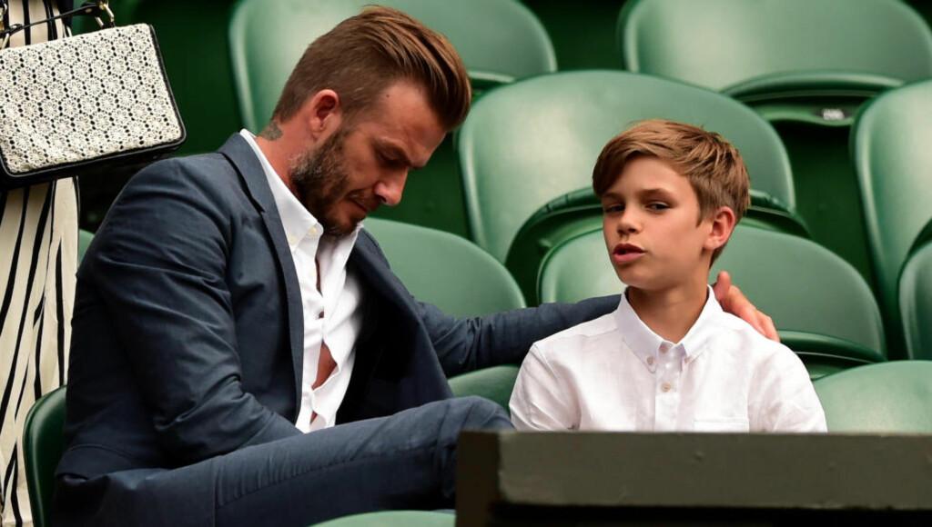 KNUST: David Beckham, her sammen med sønnen Romeo, forteller at han ble knust da en av hans sønner kom bort og fortalte at han ikke vil spille fotball mer. Foto: NTB Scanpix
