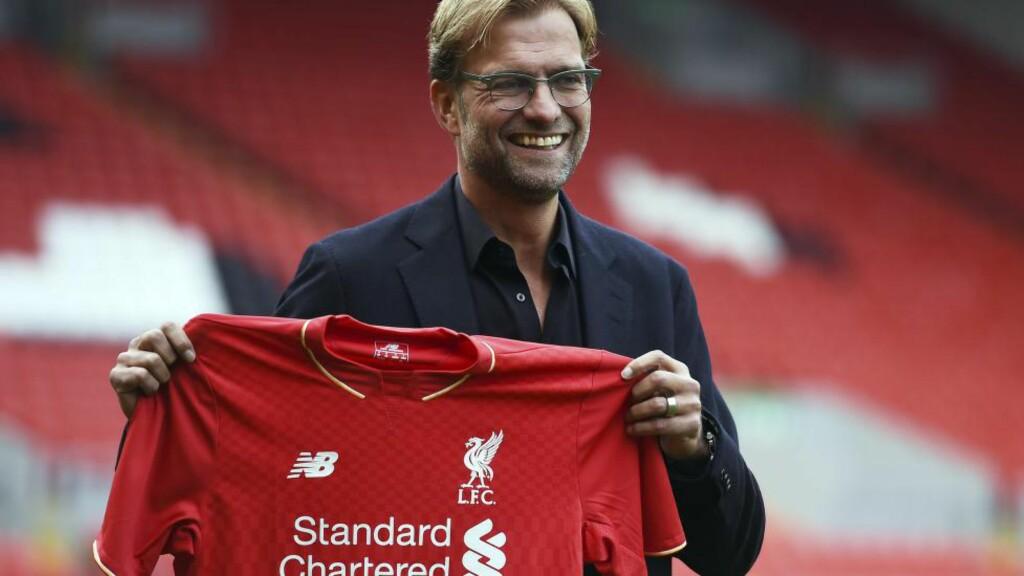 MERKER KJØRET: Det knyttes store forventninger til Jürgen Klopp. Tyskeren har allerede fått merke medieoppmerksomheten på nært hold. Foto: AFP PHOTO / PAUL ELLIS