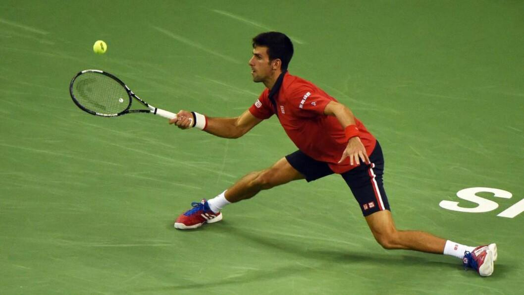 NY TITTEL: Verdensener Novak Djokovic herjet med franske Jo-Wilfried Tsonga og med settsifrene 6-1, 6-4 ble det enkel seier for serberen i ATP-turneringen i tennis i Shanghai. Foto:  AFP PHOTO / GREG BAKER / NTB Scanpix