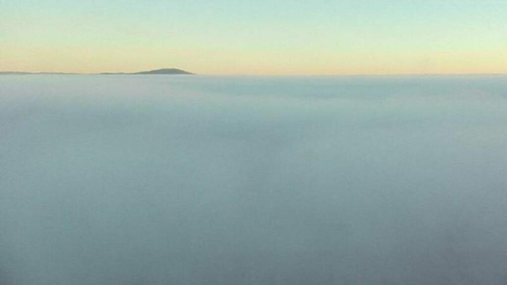 UTSIKTEN:  Dette bildet skal egentlig vise utbyggingen mot Gardermoen mot Pir Nord. I dag er det imidlertid bare tåke å se. Foto: Oslo Lufthavn