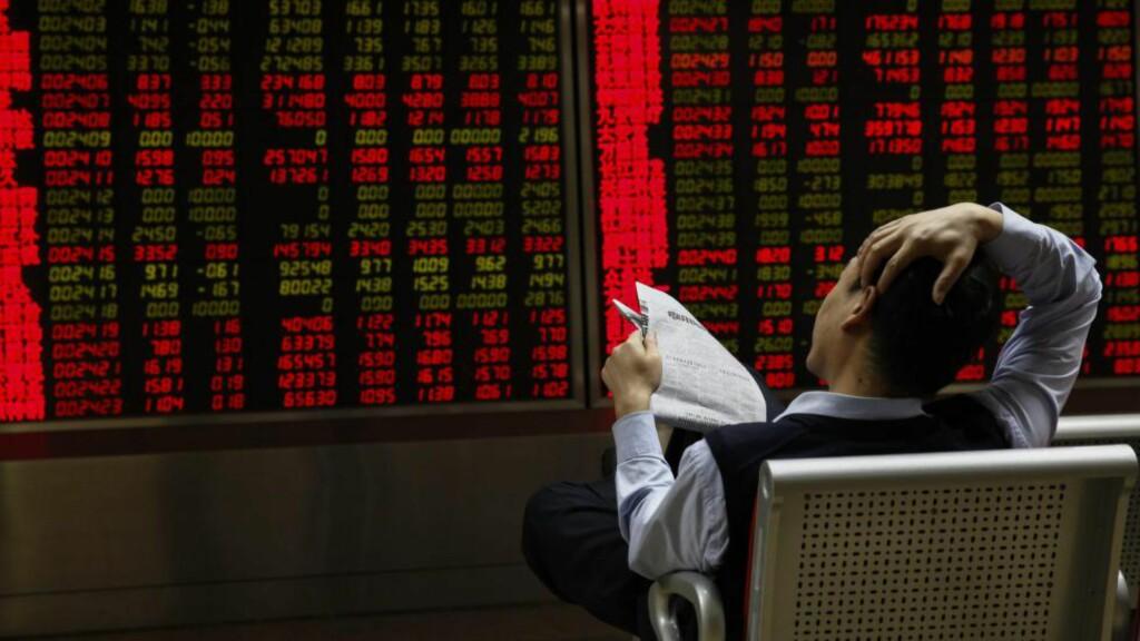 KINESISK NEDGANG: Laber situasjon på det kinesiske aksjemarkedet har mye skylda for oljefondets nedgang. Foto: EPA / ROLEX DELA PENA / NTB scanpix