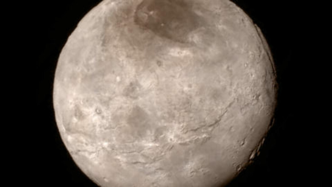 Plutos største måne Charon tatt på 466 000 meters avstand. Foto: Reuters.
