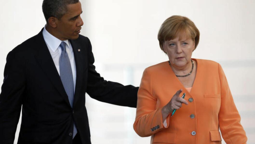 <strong>STORPOLITISK TRØBBEL:</strong>Edward Snowdens avsløringer skapte trøbbel for USAs president Barack Obama i forholdet til Tyskland og forbundskansler Angela Merkel. Her er de to i Berlin i juni 2013, da Snowdens avsløringer eksploderte i verdenspressen. Foto: AP/Michael Sohn