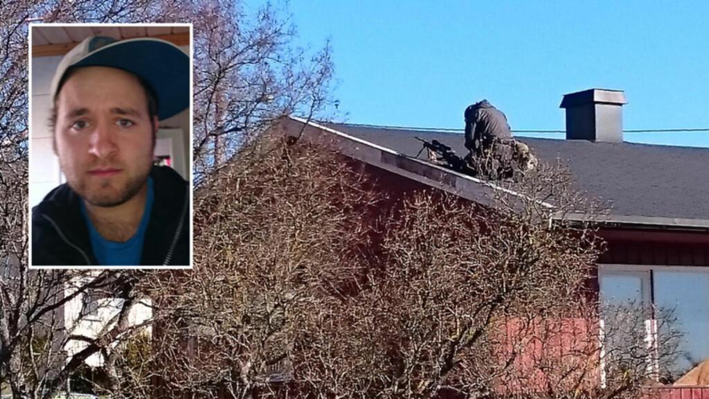 SKARPSKYTTER PÅ TAKET:  Lars Nerland (26) er nabo til huset hvor det foregår en væpna politiaksjon i Rygge. Foto: Lars Nerland.