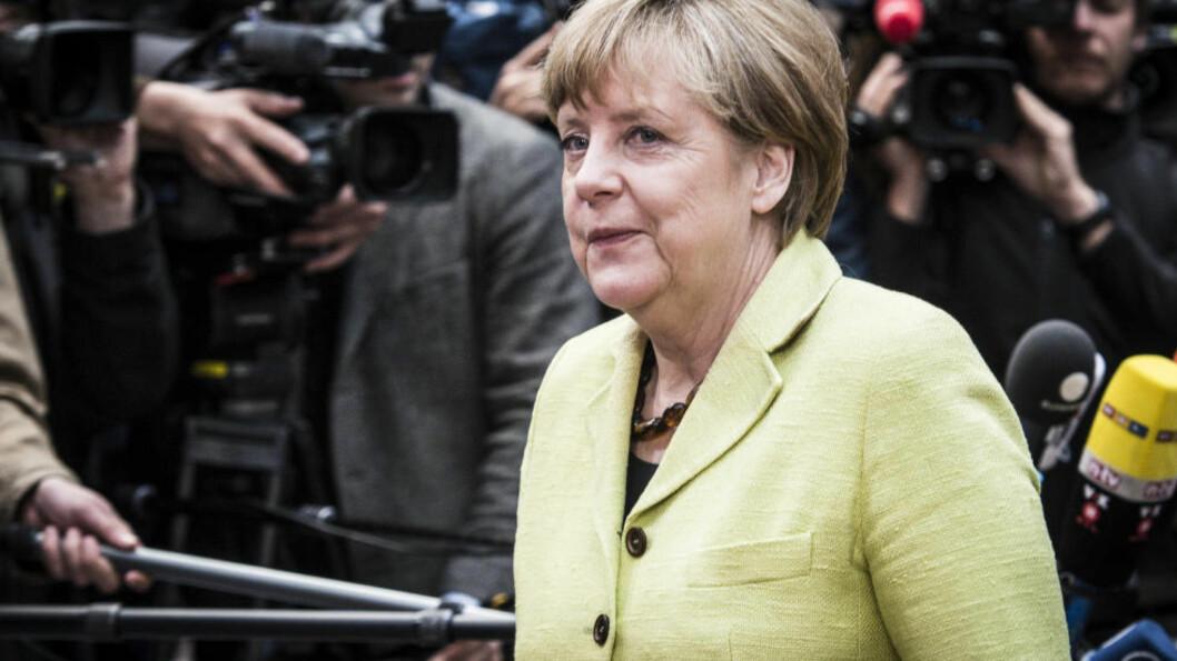 <strong>STATSLEDER PÅ KRISEMØTE:</strong>  Angela Merkel ankom i dag krisemøtet med EU-topper, IMF og den greske statsministeren. Foto:  Wiktor Dabkowski / NTB Scanpix