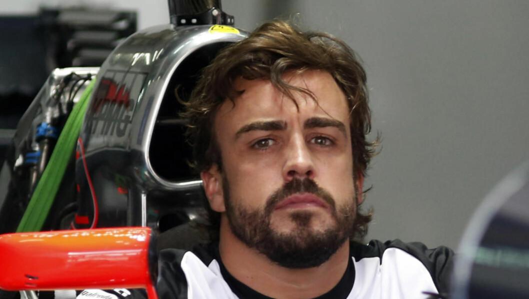 PÅ BANEN IGJEN. Stjernesjåfør Fernando Alonso kjører Malaysia Grand Prix i helga. Spanjolen er friskmeldt etter ulykken under trening 22. februar. Foto: REUTERS