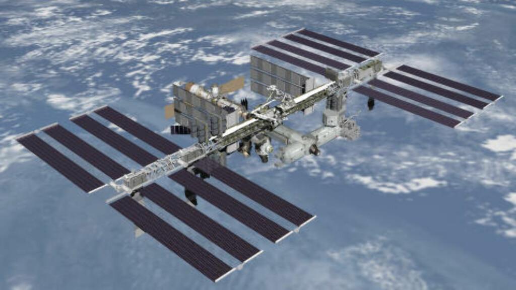 SETT FRA VERDENSROMMET:  Mange av NASAs klimaobservasjoner er gjort fra denne romstasjonen med 42 personer om bord. Foto: NASA/Reuters/NTB Scanpix.