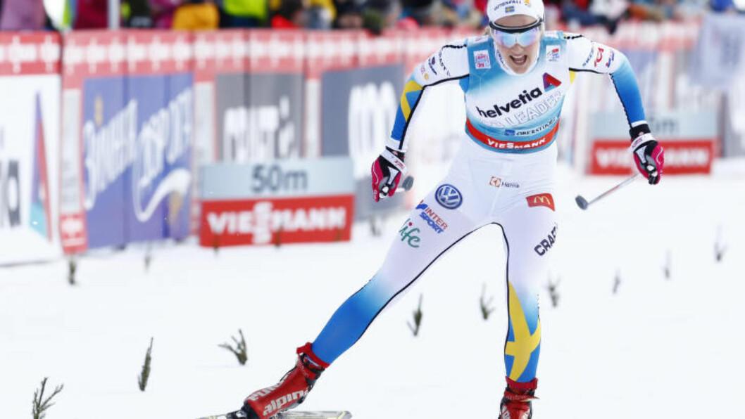 VINNER: Stina Nilsson gikk Sverige inn til seier på lagsprinten - og viste at hun er i form før VM.  Foto: Heiko Junge / NTB scanpix