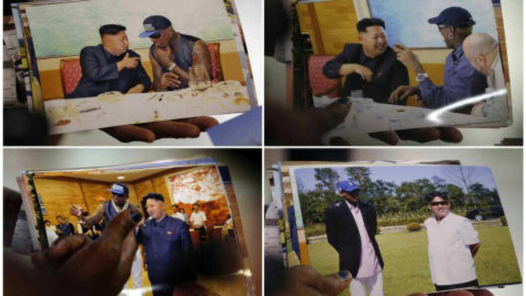 <strong>PÅ TUR:</strong> Dennis Rodman viser her frem bildene han selv fikk tatt da han gjestet diktator Kim på feriastedet i Wonsan i september 2013. Foto: REUTERS/Kim Kyung-Hoon/NTB Scanpix