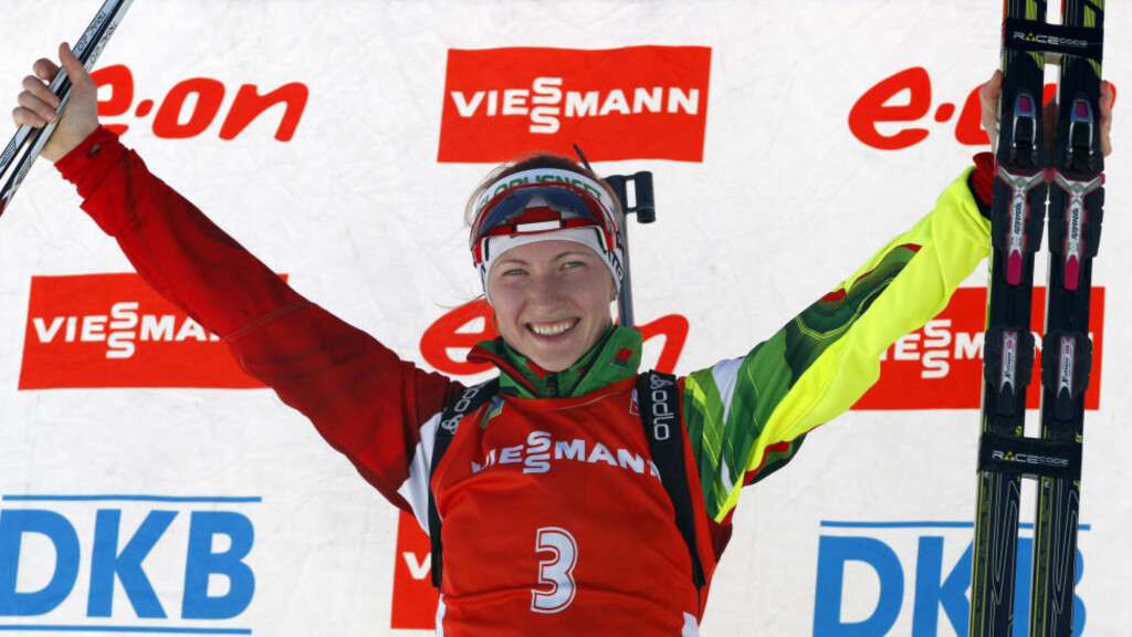 Belarus' Darya Domracheva celebrates her victory in the women's 12.5km mass start at the biathlon World Cup competition in Pokljuka, Slovenia, Sunday, March 9, 2014. (AP Photo/Darko Bandic)