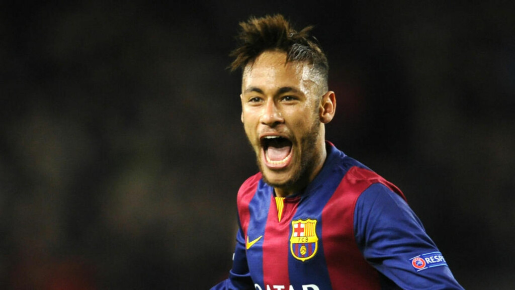 Barcelona's Neymar celebrates his side's 2nd goal during the Group F Champions League soccer match between FC Barcelona and PSG at the Camp Nou stadium in Barcelona, Spain, Wednesday Dec. 10, 2014. (AP Photo/Manu Fernandez)