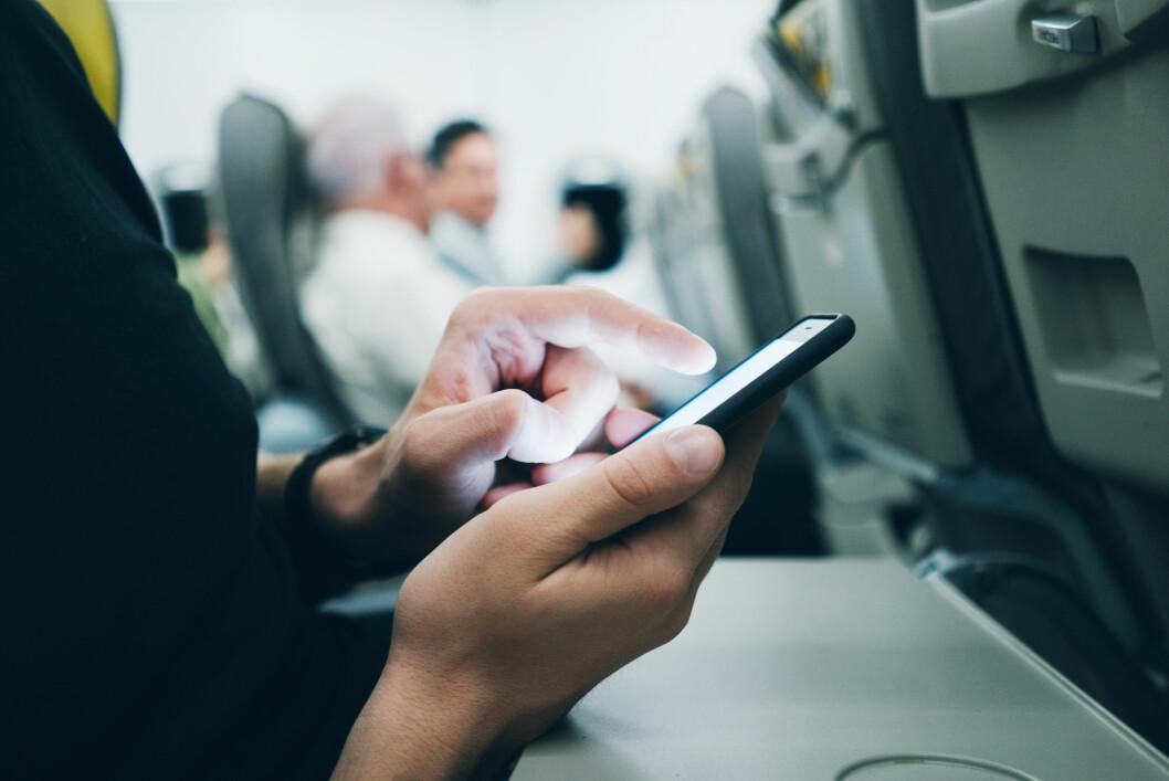 <strong>LANG FLYTUR?</strong> Godt det finnes mobilspill, si! Foto: Shutterstock / NTB Scanpix