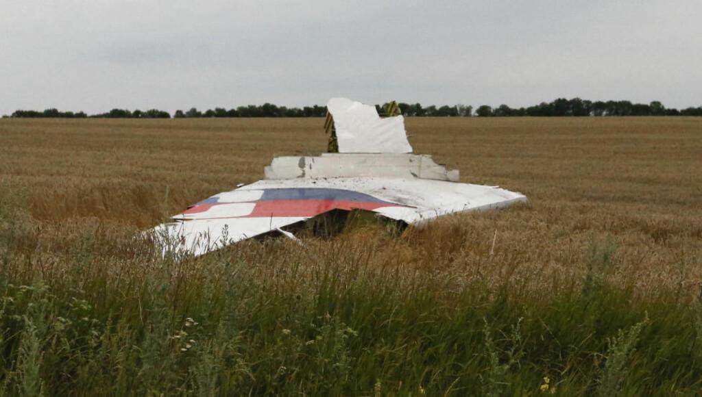KRITISK: Det kan være kritisk for bevissikringen at flyvrakrestene er blitt tuklet med før etterforskerne har fått tilgang til vrakdelene etter kastrofen med Malaysia Airlines Boeing 777 i Ukraina. Foto:  REUTERS/Maxim Zmeyev
