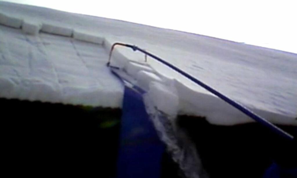 image: Så enkelt kan du få snøen ned fra taket