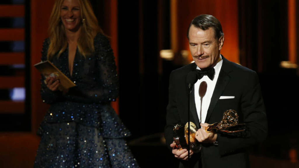 "Bryan Cranston accepts the award for Outstanding Lead Actor In A Drama Series for his role in ""Breaking Bad"" as presenter Julia Roberts listens during the 66th Primetime Emmy Awards in Los Angeles, California August 25, 2014.   REUTERS/Mario Anzuoni (UNITED STATES  - Tags: ENTERTAINMENT)   (EMMYS-SHOW)"