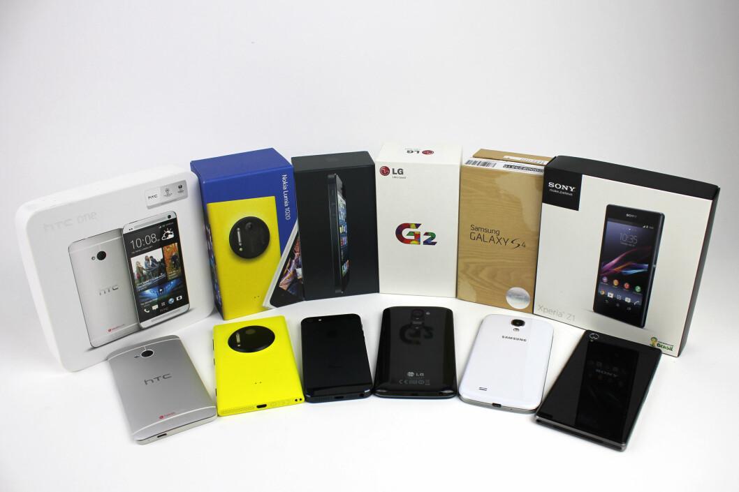 <strong>KLARE TIL KAMP:</strong> Fra venstre: HTC One, Nokia Lumia 1020, iPhone 5, LG G2, Samsung Galaxy S4 og Sony Xperia Z1.  Foto: Ole Petter Baugerød Stokke