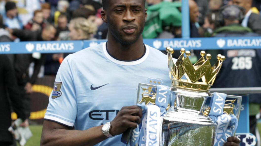 <strong>SMIL, DU HAR VUNNET:</strong> Agenten til Yaya Touré uttalte i dag at spilleren ikke trives i Manchester City. Det bekreftet spilleren selv på Twitter. Foto: AP Photo/Jon Super/NTB Scanpix