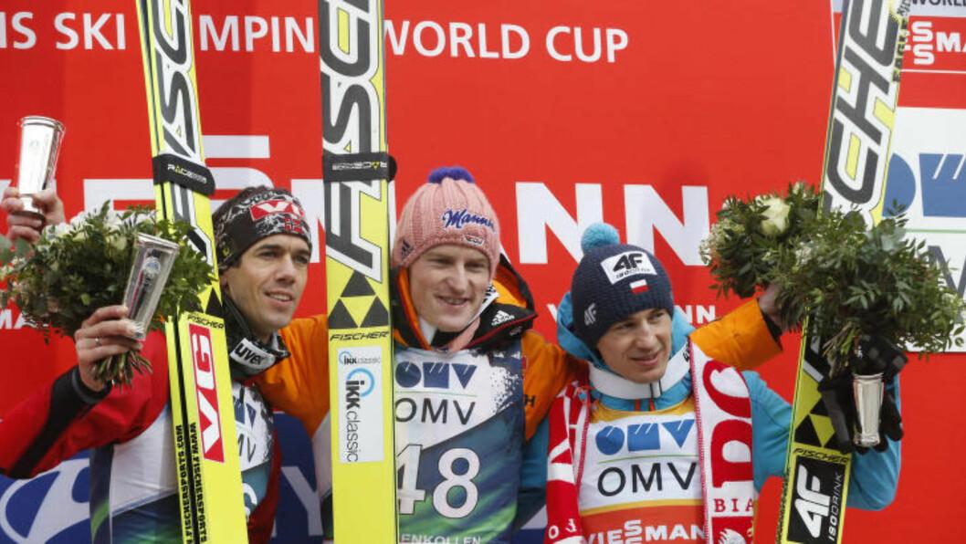 TOPP TRE:  Severin Freund (i midten) vant Holmenkollrennet foran Anders Bardal (t.v.) og Kamil Stoch. Foto: Terje Bendiksby / NTB scanpix