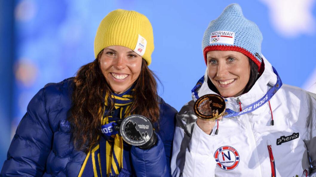 BYTTER SIDE: Marit Bjørgen har inngått en personlig sponsoravtale med sportsklær-produsenten Craft. Det er samme leverandør som konkurrenten - og kompisen - Charlotte Kalla bruker. Foto: NTB / SCANPIX