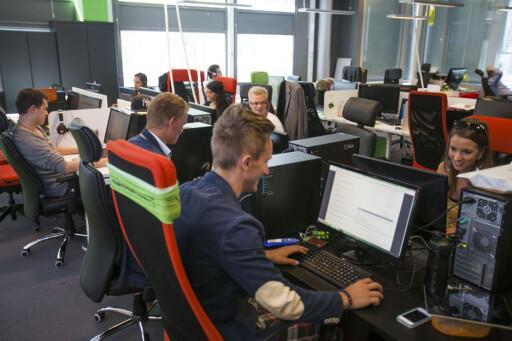TREDOBLET: Her sitter de: Den utskjelte kundeservice-avdelingen til Groupon. Antall hoder skal være tredoblet bare siden mars.  Foto: Per Ervland