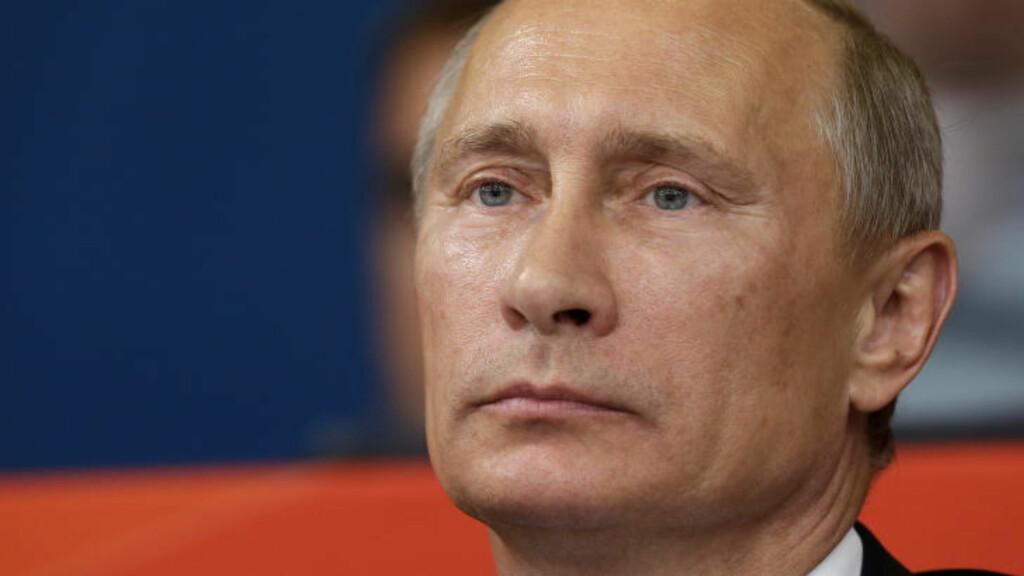 BLIR FORDØMT AV VESTEN: Russlands president Vladmir Putin og vennene hans blir utsatt for sanksjoner som følge av annekteringen av Krim. Her ser han på judo under sommer-OL i London i 2012. Foto: AP Photo/Paul Sancya/NTB Scanpix