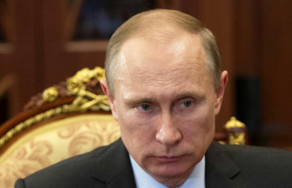 SVARER MED EGNE SANKSJONER: Russlands president Vladimir Putin svarer med samme mynt på sanksjonene fra USA og EU. Foto: AFP Photo/RIA Novosti/NTB Scanpix
