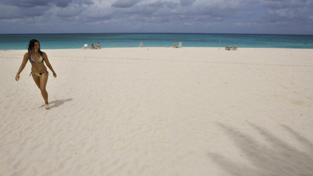 SKATTEPARADIS: Skatteparadiser som Cayman Islands benyttes hyppig av kriminelle som ønsker å hvitvaske penger. Ofte får de profesjonell hjelp til å plassere pengene sine. Foto: AP / NTB scanpix