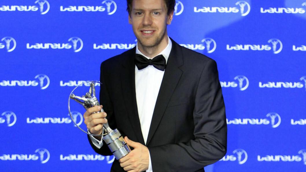 <strong>ÅRETS MANN:</strong>  Formel 1-verdensmester Sebastian Vettel og svømmestjernen Missy Franklin fikk onsdag Laureus-prisene som årets idrettsmann og -kvinne - i det som omtales som idrettens Oscar. Foto: AP Photo / Lai Seng Sin / NTB Scanpix