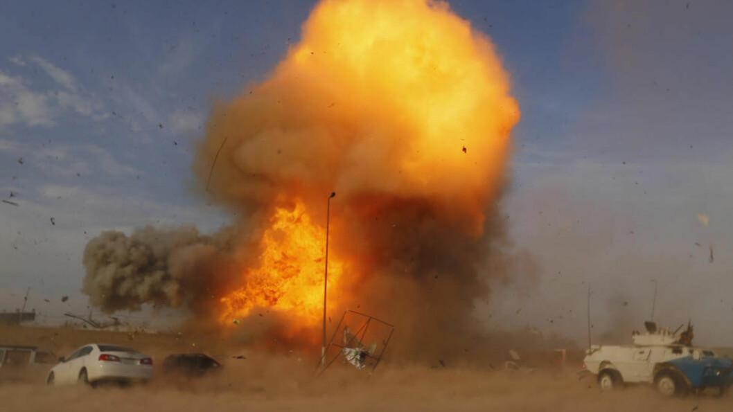 <strong>STADIG VERRE:</strong>  Tre bilbomber gikk av under et valgmøte i Bagdad fredag. Minst 18 personer ble drept, og politi og sikkerhetsstyrker fryker enda mer vold i forkant av onsdagens valg i Irak. Foto: Thaier al-Sudani/Reuters/Scanpix