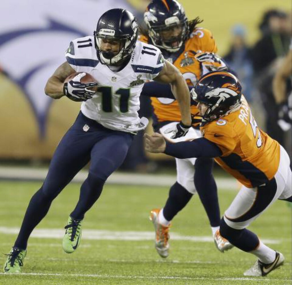 TO. THE. HOUSE: Percy Harvin løper 87 yards til en touchdown. Foto: AP Photo/Ben Margot/NTB Scanpix