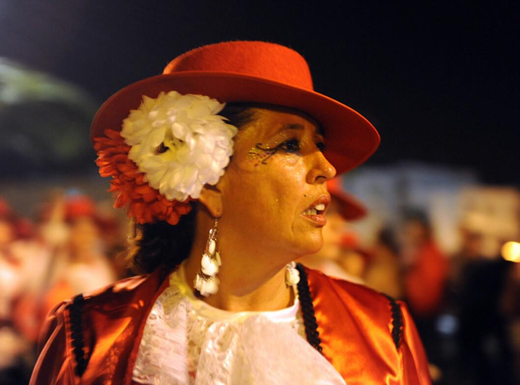En señorita som har kledt seg opp i et typisk spansk kostyme. Foto: Hans Kristian Krogh-Hanssen