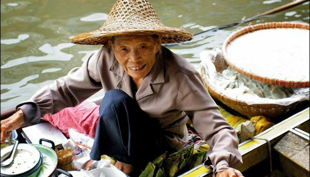 Like blid, selv om hun har smilt til turister i noen år allerede. Foto: Jon Ng