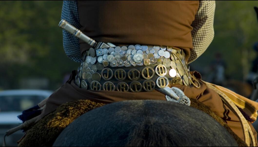 Et kalssisk belte med den lange kniven, <i>facón</i> som alle gauchoer bærer
