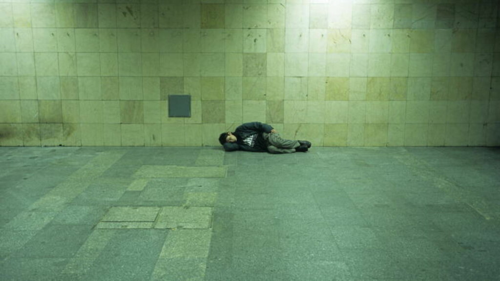 A homeless man sleeps in an underpass at Budapest s Western railway station on January 20,2005. At the moment there are between 35,000 and 40,000 homeless people in Hungary, of whom 30,000 live in Budapest. Picture taken January 20. REUTERS/Str BC-HUNGARY-HOMELESS