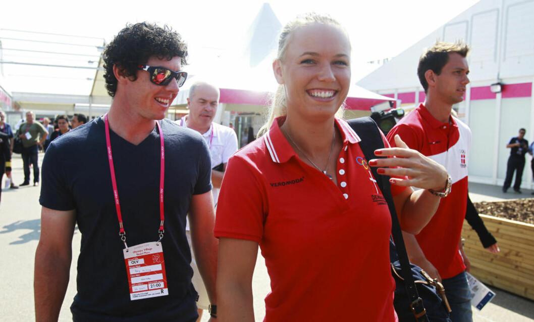<strong>RYKTER OM BRUDD:</strong> Spekulasjonene rundt tennisstjernen Caroline Wozniacki og golfkjæresten Rory McIlroy har vært mange den siste uka. Nå sier McIlroy at han ikke vil kommentere bruddryktene. Fot:  REUTERS/Alexander Hassenstein/Pool