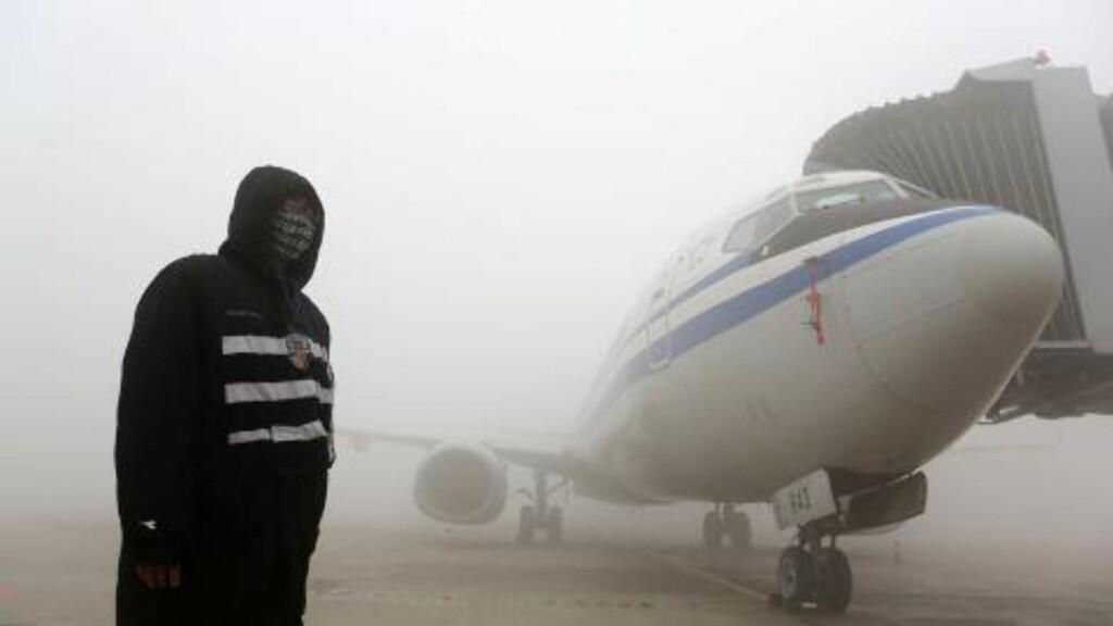 FLYSTENGT:  Flyplassen i Harbin stengte alle trafikk onsdag da den fysiske sikten i tåka ble mindre enn ti meter. FOTO: AFP/NTB Scanpix.