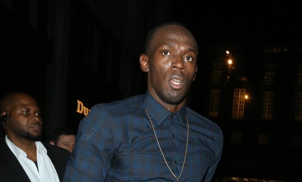 IKKE FRIDD? Usain Bolts agent hevder det ikke er sant at sprinteren har fridd til kjæresten, slik et bilde i sosiale medier antyder. Nå går også stjernen selv ut. Foto: XPOSUREPHOTOS.COM