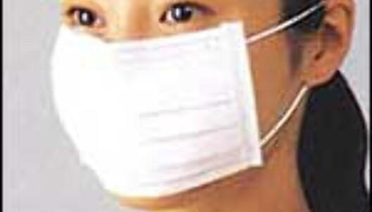Mange prøver å beskytte seg med munnbind. <I>Arkivfoto</I>