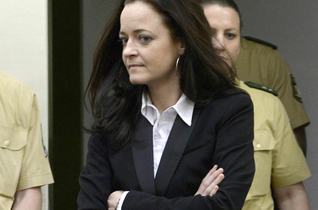 <strong>DRAPSTILTALT:</strong> Beate Zschaepe er tiltalt for medvirkning til drapet på ti personer mellom 2000 og 2007. Foto:   AFP PHOTO / CHRISTOF STACHE