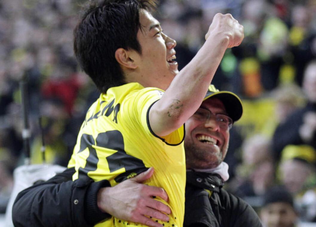 <strong>I GLANSDAGENE:</strong> Shinji Kagawa og Jürgen Klopp hadde et nært forhold da japaneren var i Borussia Dortmund. Foto: AP Photo/Frank Augstein/NTB scanpix